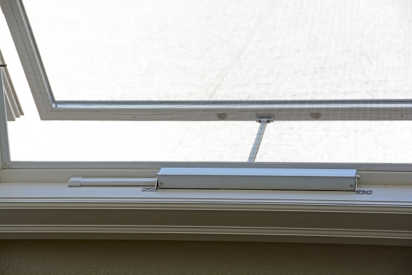 motorized-window-openers-chain-actuator-closeup-from-room