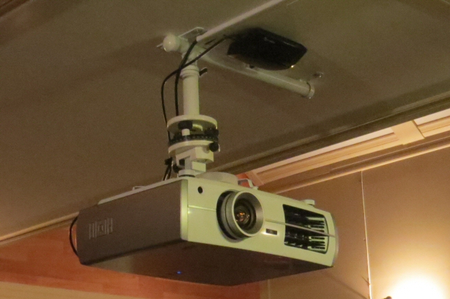 the ultimate home theater uses our CurtainCloser system with Epson triple LCD projector
