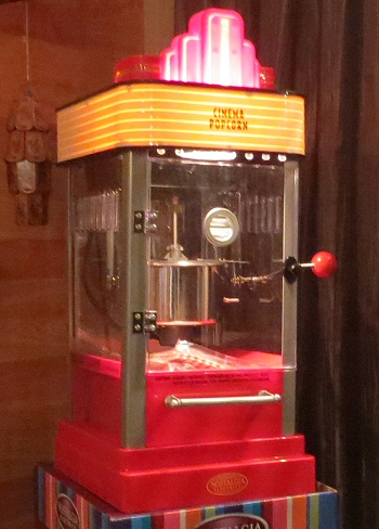 the ultimate home theater is equipped with an absolutely authentic popcorn machine